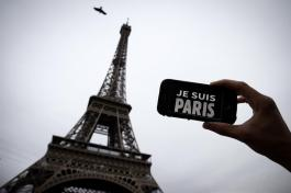 "In this illustration picture taken in Paris on November 14, 2015 a person holds aloft a smartphone bearing the message ""Je Suis Paris"" in front of the Eiffel Tour, following a series of attacks on the city in which at least 128 people were killed. Islamic State jihadists on Saturday claimed a series of coordinated attacks by gunmen and suicide bombers in Paris that killed at least 128 people in scenes of carnage at a concert hall, restaurants and the national stadium. AFP PHOTO / JOEL SAGET (Photo credit should read JOEL SAGET/AFP/Getty Images)"